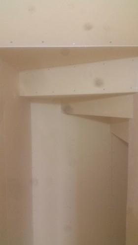 階段下の収納PB貼り